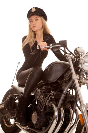 A woman cop is riding her motorcycle. Stock Photo