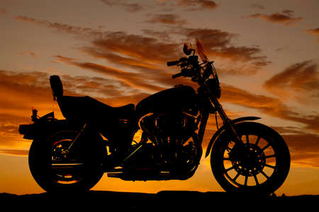 A silhouette of a motorcycle from a side view.