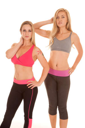 yoga pants: Two women are standing in their sports bras.