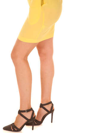 A woman in high heels and a yellow dress. photo