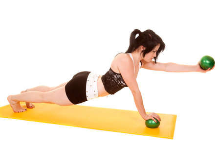 push: A woman is doing push ups holding out a ball.