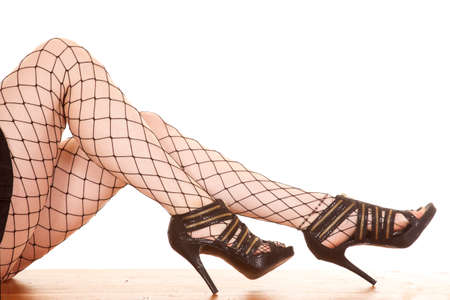A woman is wearing net tights with heels. photo