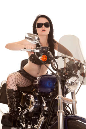 A woman sitting on her motorcycle riding in her sunglasses.