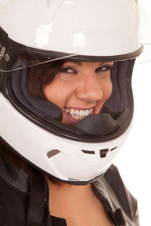 A woman in her motorbike helmet with a smile on her face. Stock Photo - 22448372