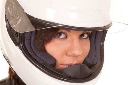 A close up of a woman biker in her helmet with a serious expression on her face. photo