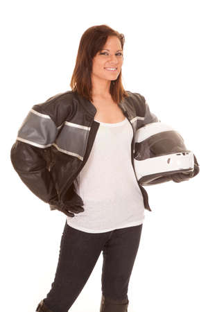 A woman with a smile on her face holding on to her helmet. Stock Photo - 22448375