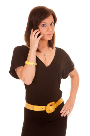 A woman with a serious expression on her face talking on her phone. photo