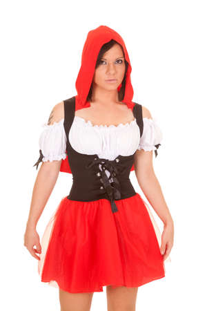 A woman in her red hood and red skirt with a serious expression on her face. photo