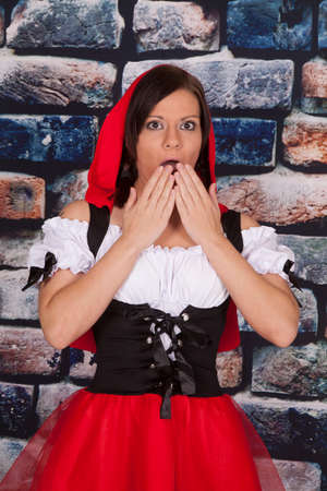 A woman shocked in her red riding hood outfit. photo