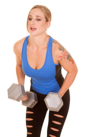 leaning forward: A woman leaning forward working out with big weights.