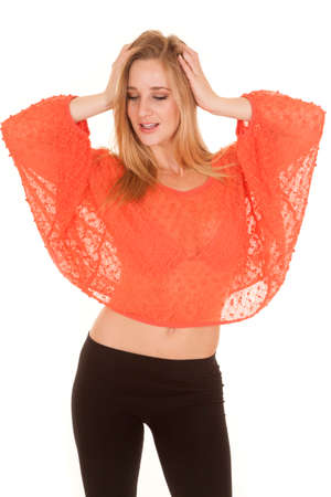 A woman is in a lace top with her arms up. photo