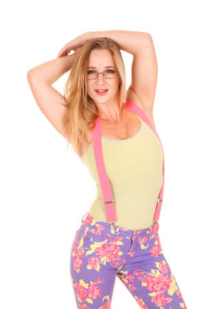 A woman is wearing glasses and pink suspenders.