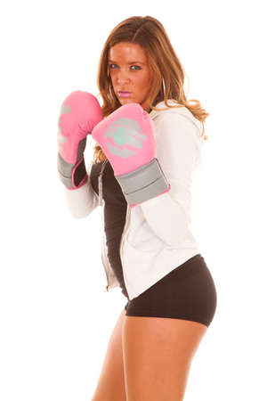 A woman in her boxing gloves with a serious expression on her face. photo