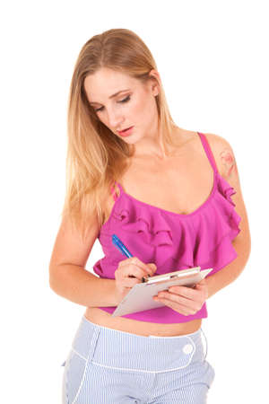 sleeve: A woman taking notes on her clip board with a tattoo on her shoulder.