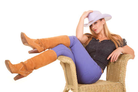 A woman sitting in her chair with her legs crossed showing off her boots. photo