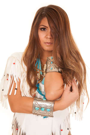 An American Indian woman in her traditional clothing, looking at the camera. photo