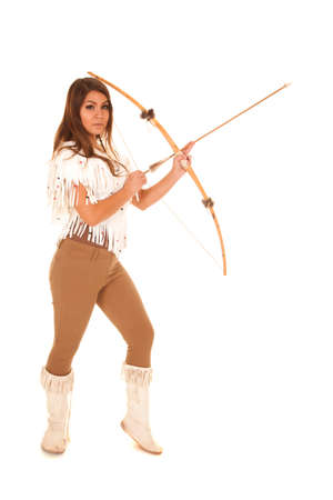 An American Indian woman in her traditional clothing holding on to her bow and arrow
