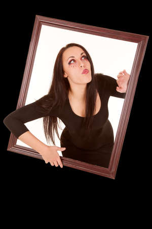 female vampire: a female vampire coming out of a picture frame. Stock Photo