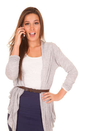 A woman is talking on the phone with a shocked expression. photo