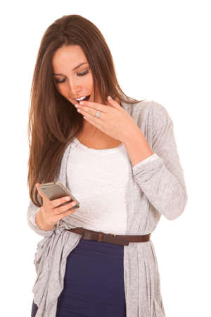 A woman is texting and has a shocked face expression. photo