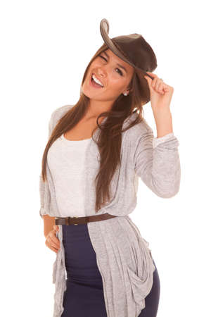 brim: A woman is winking while holding the brim of her hat. Stock Photo