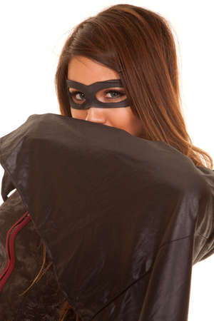 A woman dressed as a bandit is looking over her cape.
