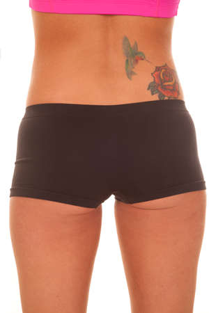 spandex: A woman has a tattoo on her lower back.