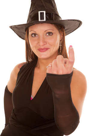 motioning: A witch is motioning to come with her finger.