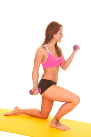 A woman is holding weights and curling them. photo