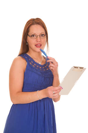 A woman in a blue dress is holding a pen and notepad. photo