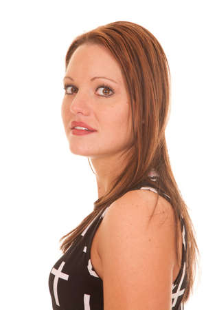 A woman is looking to the side and smiling. photo