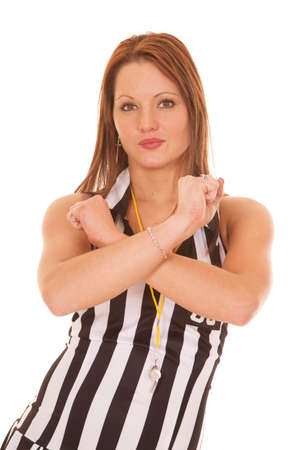 bracelet tattoo: A female referee is giving a sign by crossing her arms. Stock Photo
