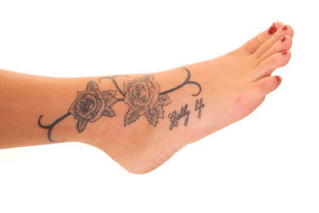 A woman has a rose tattoo on her foot.