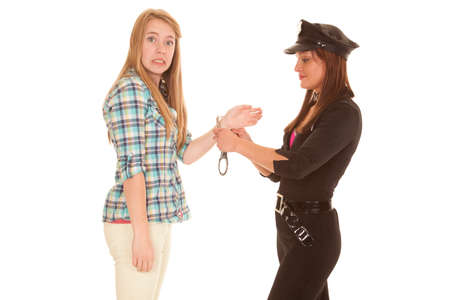 handcuffed: A woman is upset that she is being handcuffed. Stock Photo