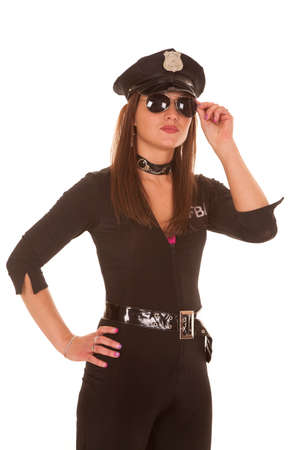 policewomen: A female cop is holding her glasses over her eyes.