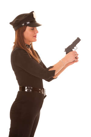 policewomen: A woman is holding her pistol and looking at it.