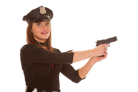 policewomen: A woman is holding up a gun and smiling.