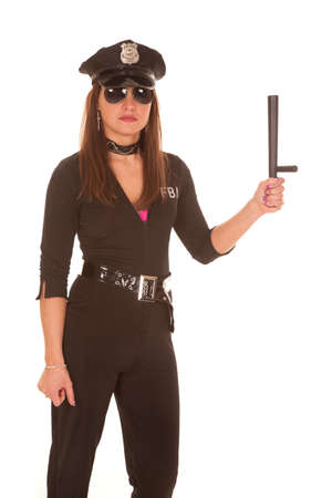 policewomen: A female cop is holding a stick in her hand. Stock Photo