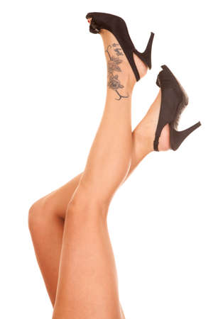 A woman with a tattoo on her foot is wearing heels. photo