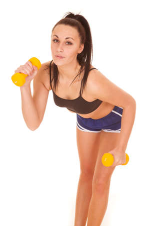 a woman leaning over with her weights with a serious expression. photo