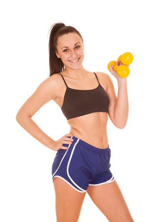 a woman with a smile on her face holding on to her weights. photo