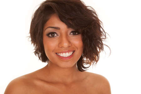 A Hispanic woman with a big smile on her lips. photo