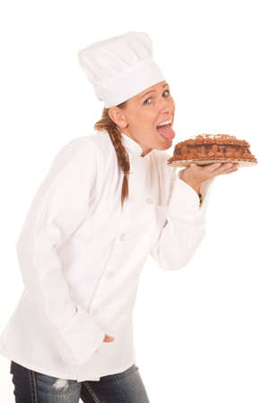 whites: A woman baker getting ready to lick her chocolate cake.