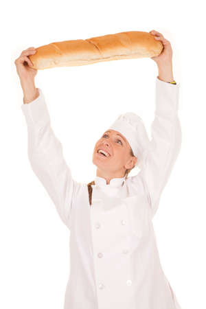 a woman chef so happy with her loaf of bread she is holding it up over her head, Stock Photo - 23926549