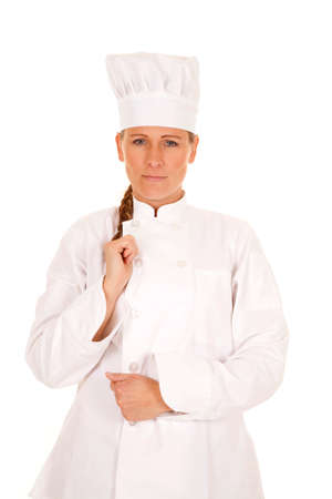 a woman chef posing, while holding on to her chef jacket Stock Photo - 23926495