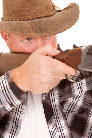a close up of a cowboy holding on to his gun. photo