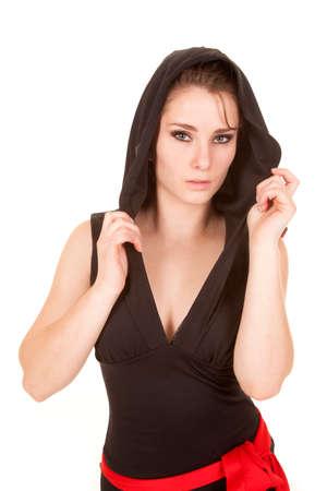 彼女の顔に真剣な表情で彼女の黒のフードであります。 写真素材