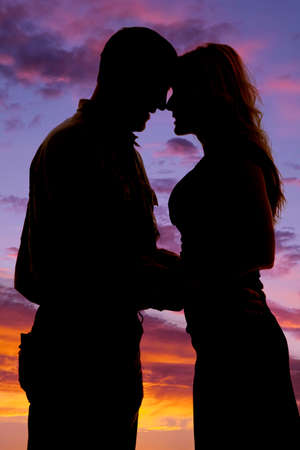 holding close: A silhouette of a man and woman with their heads together