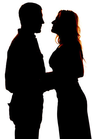 a silhouette of a man and woman infront of a white background. photo