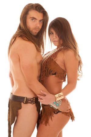 A couple in their loincloth clothing holding on to each other photo